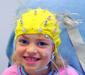child wearing EEG cap for brain study