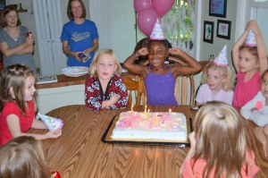 Ella blowing out candles on her birthday cake